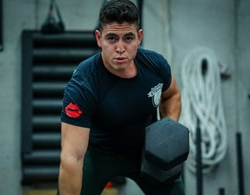 Gustavo Ramos performing dumbbell rows at seriously strong trainings personal training gym